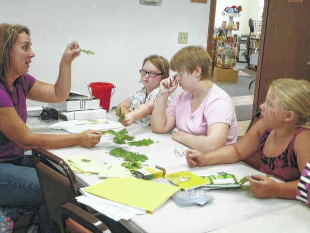 Jeffersonville Branch Library was the place to be to learn to identify some common trees by using a key and investigate why trees are important. The program was presented by Brigitte Hisey, natural resource specialist of the Fayette Soil and Water Conservation District recently. They also created a pretty bracelet.