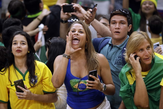 Fans cheer after Brazil defeated Mexico during a men's preliminary volleyball match at the 2016 Summer Olympics in Rio de Janeiro, Brazil, Sunday, Aug. 7, 2016. (AP Photo/Matt Rourke)