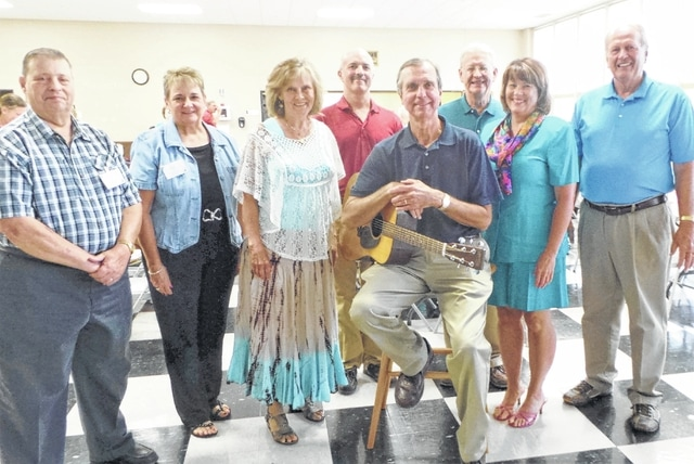 """The talented """"Men of Grace"""" quartet provided the entertainment for this year's """"summer picnic"""" of the Fayette County Retired Teachers Association in an especially familiar setting for the musicians: the air-conditioned Fellowship Hall of Grace United Methodist Church. An audience of 60 enjoyed the program after a dinner catered by The Willow. Shown are (from left) FCRTA Vice President Ron Lott, FCRTA President Norma Kirby, and Grace Methodist's accompanist Jeanne Rosendahl, Greg Conrad, Vic Pontius (holding guitar), Mike Jenks, guest vocalist Cindi Grover and Jim Rosendahl."""