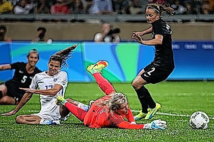 New Zealand goalkeeper Erin Nayler, center, makes a save against United States' Tobin Heath during a women's Olympic football tournament match at the Mineirao stadium in Belo Horizonte, Brazil, on Wednesday. The United States won 2-0. Heath showed no sign of the hamstring injury that had bothered her before the Rio Olympics.