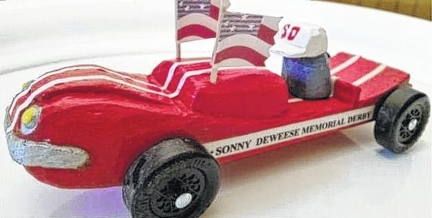 Pictured is the race car Bev Mullen carved for the Pinewood Derby honoring Sonny Dewees.
