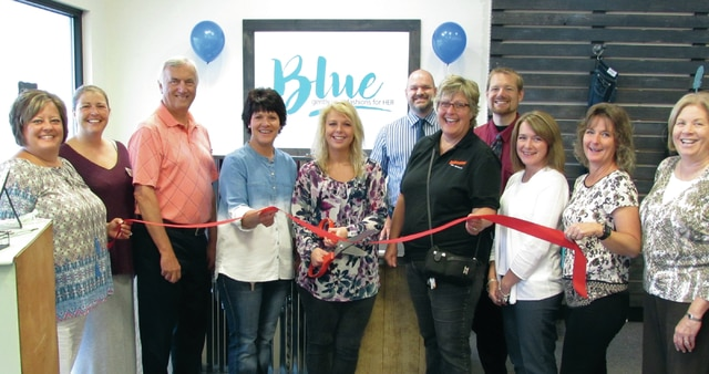 """A grand opening ribbon-cutting was held Monday morning at the new """"Blue: Second-hand Fashions for Her"""" boutique in Washington Court House. Featuring trendy and many name-brand fashions for women, it's the first of its kind in the lineup of stores in the eight-county territory of Goodwill Industries of South Central Ohio. Blue is located at 1377 Leesburg Ave., across from the entrance to the Fayette County Fairgrounds. Pictured at the ribbon-cutting are: Fayette Chamber of Commerce President Whitney Gentry, Mekia Rhoades, Goodwill Executive Director Marvin Jones, WCH Goodwill manager Toni Copas, assistant manager Bethany Ogden, Goodwill Retail Coordinator Jerrod DePugh, Colleen Roundhouse, Goodwill Marketing Coordinator Joe Parker, Julie Bolender, Kathy Patterson, and Ruth Ann Ruth."""