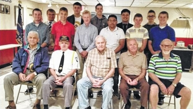 """Pictured left to right, starting with the Buckeye Boys' State attendees: Kyler Mount, Jared Murphy, Blake Pittser, Seth Leach, Todd Peterson, Griffin Shaw, Alex Patel, Chance Oyer, Nick Elrick, Levi Davis and Liam Downing. Not pictured is Colton Karnes. In the front row are Charles """"Buck"""" Harris (American Legion Post #653), Dave Frederick (Commander, American Legion Post #25), Robert Malone (Veterans of Foreign Wars Post #3762), Edward Fisher (Selection Committee member), and Paul Sands (Fayette Masonic Lodge #107)."""