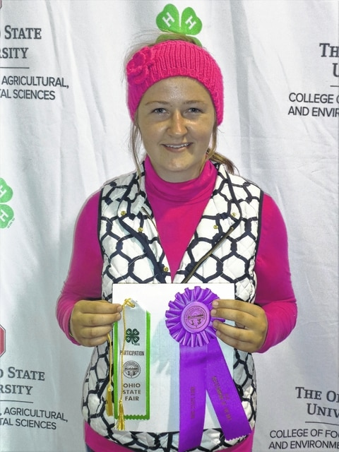 """Victoria Schappacher, of Good Hope, won Outstanding of the Day at the 2016 Ohio State Fair in """"Looking Great for Less Clothing"""" category. She is a member of Pigs-N-Things 4-H Club and a junior at Ohio Virtual Academy. Schappacher is the 16-year-old daughter of Leo and Mari Schappacher."""