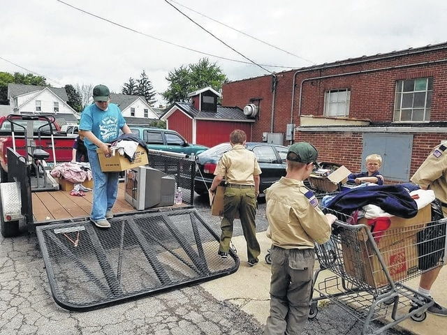 Cub Scouts donated household items July 5 to The Well at Sunnyside.