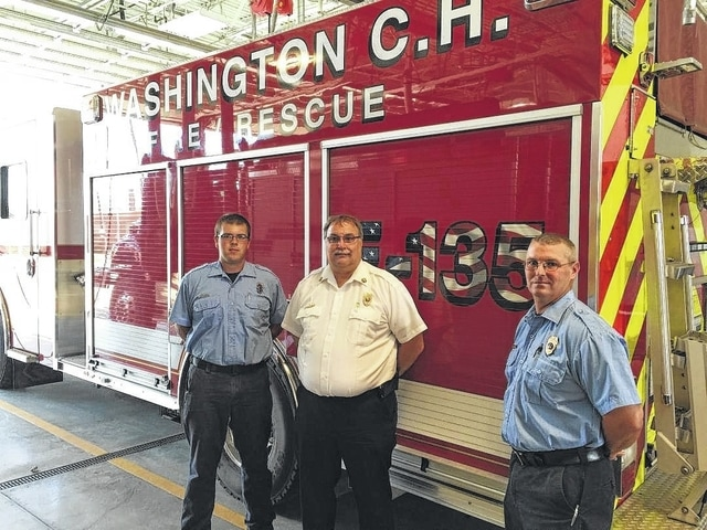 """The Washington C.H. Fire Department's newest, multi-functional fire truck will be in full service this Thursday. """"We will be doing training with the new truck the next couple of days so the guys know exactly how it works,"""" said Tom Youtz, the chief of the Washington Fire Department. This truck - a 2014 Rosenbauer - was purchased from All-American Fire Equipment, a local company. According to Scott Monroe, of All-American Fire Equipment and also a part-time firefighter, there is a compartment at the front of the truck that will house two 100-foot hydraulic reels, a rescue pump, rescue tools, and up to 150 feet of pre-connected hand-line hose. This truck carries 1,000 gallons of water and features a 1,500-gallon-a-minute pump. The truck has a better turning ratio than """"141"""" and has a shorter wheel base. Pictured are Matt Smith, Chief Tom Youtz, and Lt. Tim Downing."""