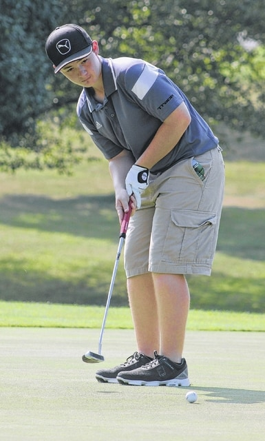 Miami Trace sophomore Hayden Walters watches his putt on the No. 9 green during the McClain Invitational Friday, Aug. 5, 2016 held at Buckeye Hills.