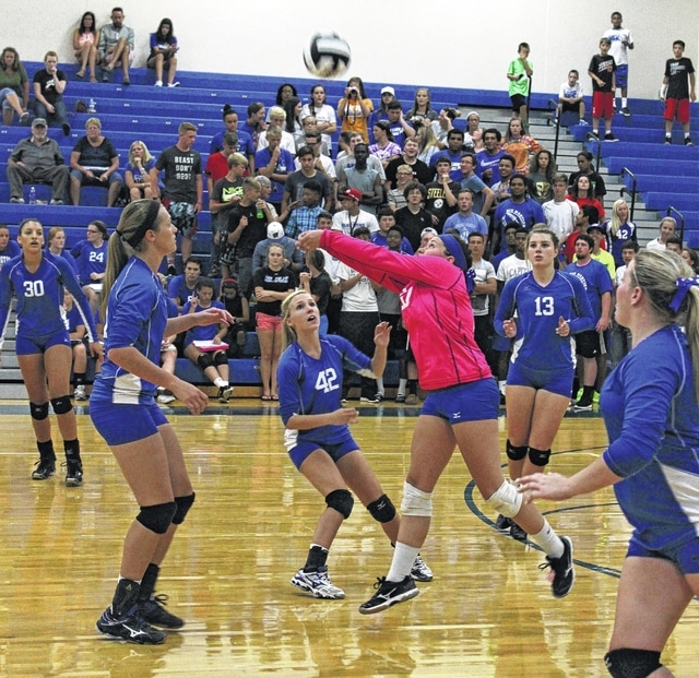Haley Maxie passes the ball up for the Lady Lions during an SCOL match against Chillicothe Thursday, Aug. 25, 2016 at Washington High School. (l-r); Hannah Haithcock (30), Victoria Jones, Taylor Long (42), Maxie, Madalyn Wayne (13) and Delaney Greer.