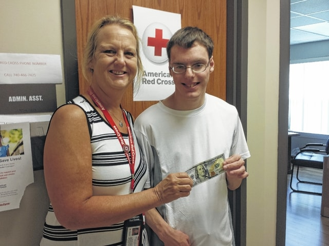Mary McCord, disaster program specialist with the American Red Cross, accepted a donation from Jimmy Clark on his birthday Thursday of $100. Clark has donated for years and gave the largest amount he has ever given on his birthday.