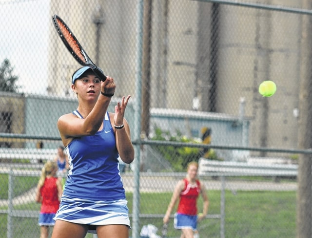 Washington's Megan Downing returns a shot during a first singles match against Clinton-Massie Wednesday, Aug. 17, 2016 at Gardner Park.