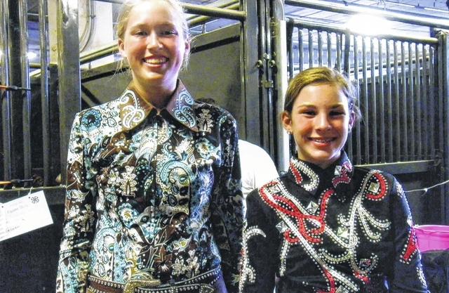 Fayette County had two representatives participating in the Ohio State Fair Horse Show. Andrew Robinson, left, showed in horsemanship and western pleasure, and Madison Johnson, right, showed in showmanship, horsemanship and western pleasure. They are both members of the All-N-One 4-H Club.