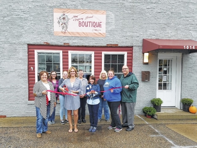 Kelly Pavey, owner of My Gypsy Soul Boutique & Trading Co., LLC, cuts the ribbon at her 1014 Leesburg Ave. boutique, surrounded by Fayette County Chamber of Commerce Ambassadors, friends and city officials.