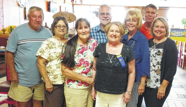From left to right, Modern Woodmen members Jim Goolsby, Connie Goolsby, Debra Grover, Altrusa President Cathy White, District Agent: Dan Mayo, Modern Woodmen members: Bev Mayo, Wayne Arnold and Leslye Arnold.