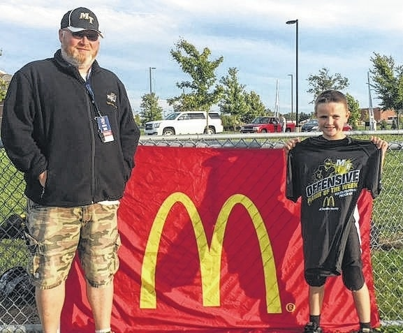 Ben Matthews, above, right, is the offensive Player of the Week for week No. 5 of the Miami Trace Youth Football Program 2016 season. He is a member of the Miami Trace 5th grade Black team. At left is his coach, Nick Phillips.