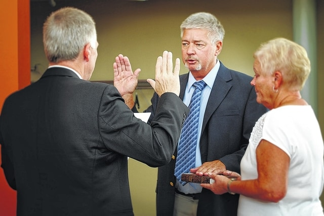 Doug Boedeker (center) of Washington C.H. was sworn in to his second term as a member of the Southern State Community College Board of Trustees by the Honorable David B. Bender, Fayette County Probate Court Judge. Boedeker is joined by his wife Pam (right).