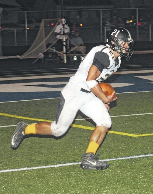Miami Trace junior Brady Wallace returns a kickoff 92 yards for a touchdown against Chillicothe in an SCOL game played in Ohio's first capital Friday, Sept. 23, 2016.