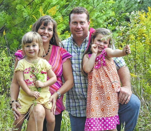 Randy and Monique Hughes and their family.