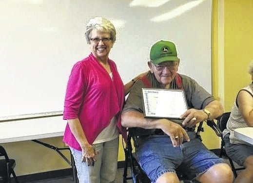 Roger Boysel receiving his certificate from Fayette Fat Fighters with Jeannie Bihl, R.N., who is a nurse at the health department and leads the group.