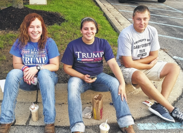 Wilmington College students lined up for Thursday's rally for Donald Trump at the Roberts Centre, from left, Molly Harshbarger of De Graff, Ohio, Laura Swinehart of Lancaster and Cole Flesher of Springfield.