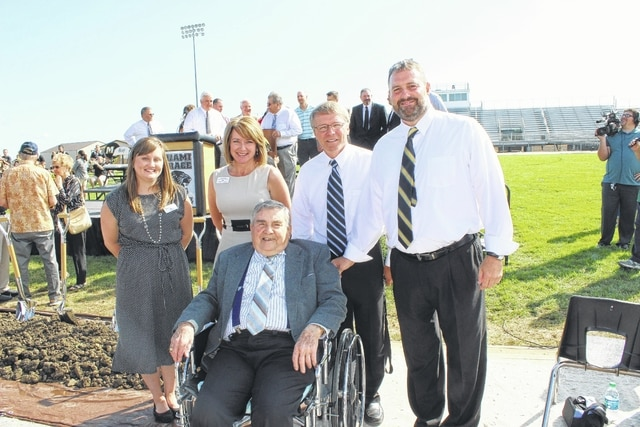 Miami Trace Local Schools held a groundbreaking ceremony at the track and football field on Thursday morning to signal the start of work on a brand new high school to be completed in 2019. Pictured is Curtis E. Fleisher (middle), the record holder for longest service as the leader of the Miami Trace High School and its third principal. He was visiting from Court House Manor on North Glenn Avenue in Washington Court House and he enjoys regular visits from his wife Janet and his son David. He is pictured with Tiffany Cline, social worker at Court House and St. Catherine's Manor; Julie Bolender, in charge of business development at Court House and St. Catherine's Manor; Rob Enochs, current Miami Trace High School Principal and David Lewis, Miami Trace Superintendent.