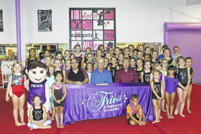 City Manager Joe Denen, City Council Chairman Dale Lynch and Fayette County Commissioner Tony Anderson recently visited Trics Gymnastics Academy, in Washington Court House, to explore the facility and celebrate National Gymnastic Day with the athletes there. The facility is owned by Mark and Susan Holloway, who are also the main coaches at their gym.