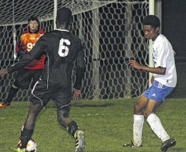 Washington's Kenny Upthegrove, at right, defends against Charly Schumacher (6) of Wilmington during an SCOL match at Washington High School Thursday, Sept. 29, 2016. Also pictured for the Blue Lions is goalkeeper Brian Wilson.