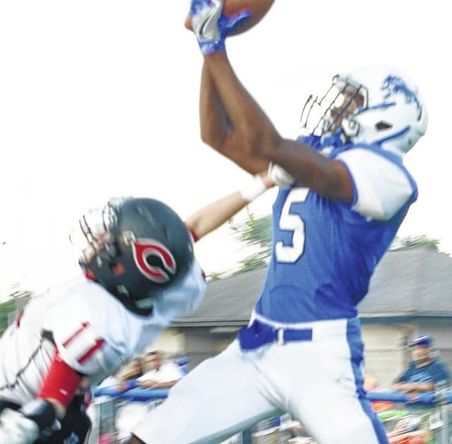 Kory Proby (5) makes the touchdown catch in the first quarter for the Blue Lions, one of five touchdown passes on the night by Jarett Patton, in a 48-42 win over the Circleville Tigers at Gardner Park Friday, Sept. 2, 2016.