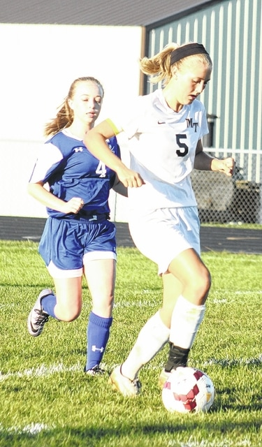 Miami Trace's Lauren Truex (5) advances the ball against Chillicothe during an SCOL match at Miami Trace High School Thursday, Sept. 15, 2016.
