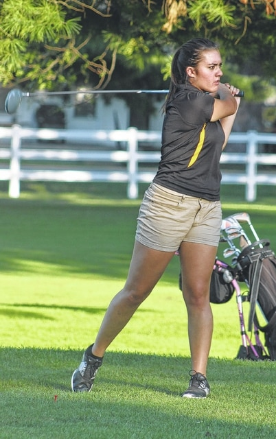 Miami Trace's Makayla Eggleton watches the flight of her fairway drive during an SCOL match against Hillsboro at the Club at Quail Run Wednesday, Sept. 21, 2016.