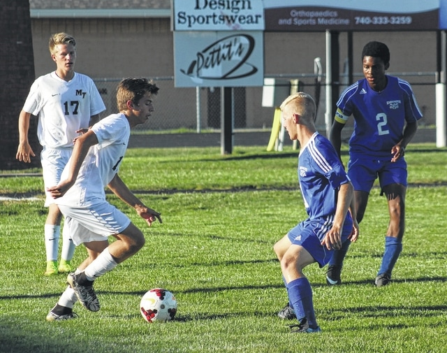 Brett Lewis (left) controls the ball for Miami Trace against Washington's Seth Hanusik during an SCOL match Tuesday, Sept. 13, 2016 at Miami Trace High School. Also pictured: Kody Burns (17) for Miami Trace and Kenny Upthegrove (2) for Washington.
