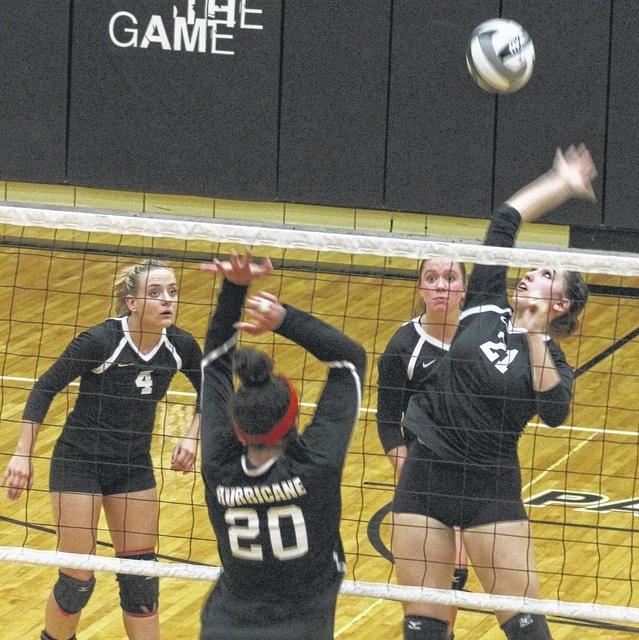 Miami Trace's Kylie Reisinger makes the hit at the net during an SCOL match against Wilmington Thursday, Sept. 22, 2016 at Miami Trace High School. Also pictured for Miami Trace are (l-r); Ashley Campbell (4) and Clare Sollars.