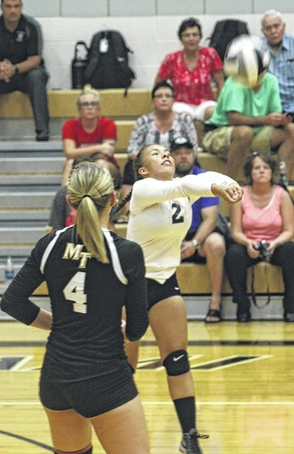 Dyamin Baker (2) passes the ball up for the setter for Miami Trace during an SCOL match against Hillsboro Tuesday, Sept. 6, 2016. Also pictured for the Lady Panthers is Ashley Campbell (4).