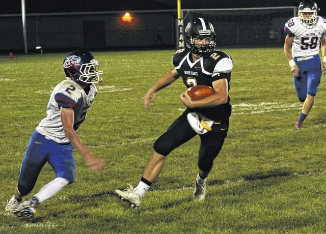 Skyler McDonald carries for Miami Trace during an SCOL game against Clinton-Massie Friday, Sept. 16, 2016. Pictured for Massie is Luke Richardson (2).