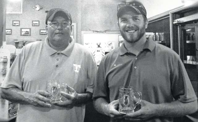 Jeremy Smith and Justin Bihl celebrate after winning the Deer Creek Wednesday Evening Golf League. They won by ten points in the Aug. 31 playoffs. The second place team was composed of Jack Webb and Danielle Ponthieux. The third place team were previous years winners James Kirby and Jerry Burris (2010, 2011). The league begins in early May and continues through September. The league is open to golfers of all skill levels and is fun and filled with camaraderie.
