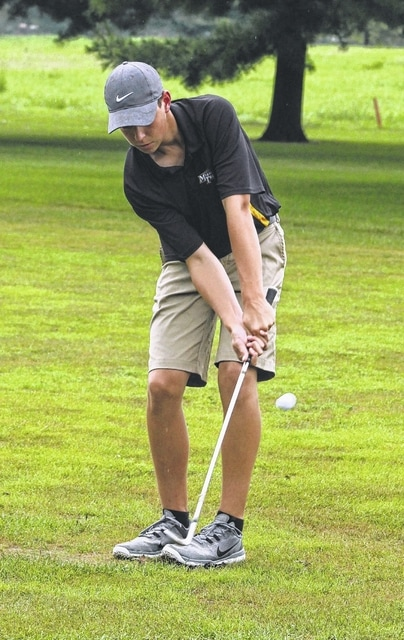 Miami Trace sophomore Tyler Eggleton chips onto the No. 1 green at the Club at Quail Run during an SCOL match against Chillicothe Wednesday, Aug. 31, 2016. Eggleton shot a career-best 9-hole score of 38 for the Panthers.