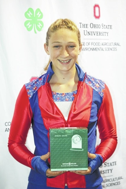 """Victoria Waits, of Washington Court House, won """"Outstanding of the Day"""" and a clock trophy at the 2016 Ohio State Fair in the active sportswear category. Waits is a member of Perry Peppy Farmers 4-H Club and is a ninth grader at Miami Trace High School. Waits is the 14-year-old daughter of Daryl and Kris Waits."""