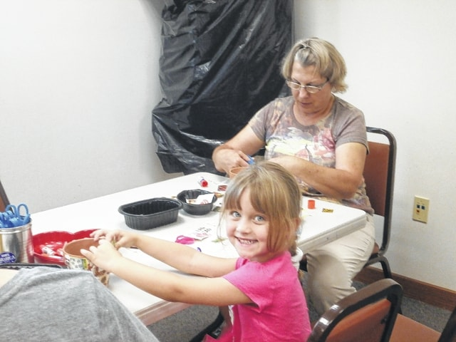 Jeffersonville Branch Library recently celebrated Grandparents' Day by having a craft workshop where participants were able to create a beautiful card and a decoupage vase or pot. Here, Gabriella Webb is shown creating a decoupage pot while her Grammy Wendy Decker is creating one too. Special memories made at the library.