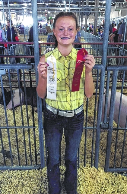 Laikyn Hughes, member of the 4-H Barn Buster Club, participated in the Ohio State Fair and won reserve weight champion in a market swine class and third place in a swine market class.