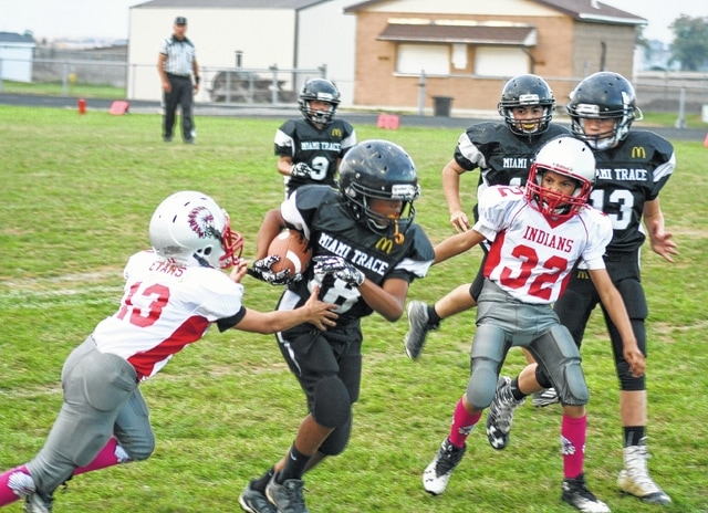 Trevaughn Jackson (18) carries for the Miami Trace sixth grade Black team. Also pictured for Miami Trace are Jacob Miller (9), Bryson Sheets (12) and Austin Etzler (13).