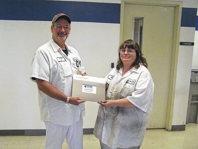 Kimberly Strahler recently celebrated her 15-year anniversary with YUSA Corporation. Presenting her with her gift is supervisor, Marcus Harris.