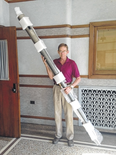 Craig Jaynes with one of the organ's original 622 pipes. The pipe was taken to Alliance, Ohio where it was repaired.