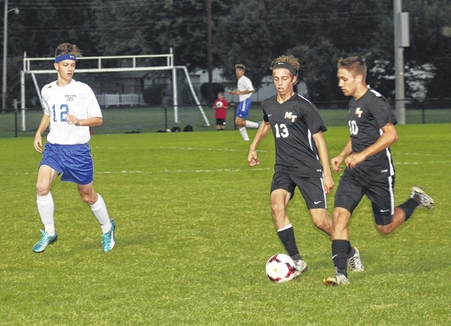 Miami Trace's Brett Lewis (13) and Blake Pittser (10) bring the ball upfield against Washington's Jordan Behm during an SCOL match Thursday, Oct. 6, 2016 at Washington High School. Pittser scored two goals to set a new Miami Trace school record of 55 career goals. Lewis had three assists in a 3-0 Panther victory.