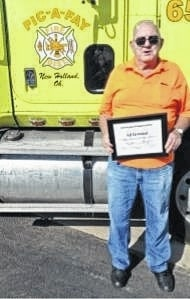 Ed Orihood with his certificate recognition for 55 years of service to his community as a firefighter.
