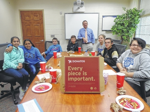 "Donatos recently provided pizza to these students at Washington Middle School as they celebrated ""Pizza with the Principals."" This is in appreciation for their selection as Students of the Month for September. They are chosen by their teachers because of the outstanding example they set for their peers in such areas as academic effort, good work ethic, kindness to others, and service to their school. Pictured from left: Navneet Kaur, Harmanpreet Kaur, Ethan Westendorf, Karson Runk, Mr. Montgomery, assistant principal, Emily Becker, Devin Ison, and Emily Jacobs. Absent from picture Nakhia Pacheco-Vasquez."