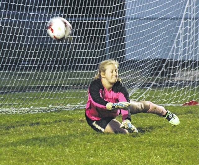 Miami Trace senior goalkeeper Taylor Barrett dives and deflects a shot away during an SCOL game against Hillsboro Tuesday, Oct. 11, 2016 at Miami Trace High School.