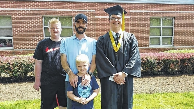 Mark Groves and his three sons. A fundraiser will be held for Groves this Friday at the American Legion Post 25 to assist with his medical expenses.