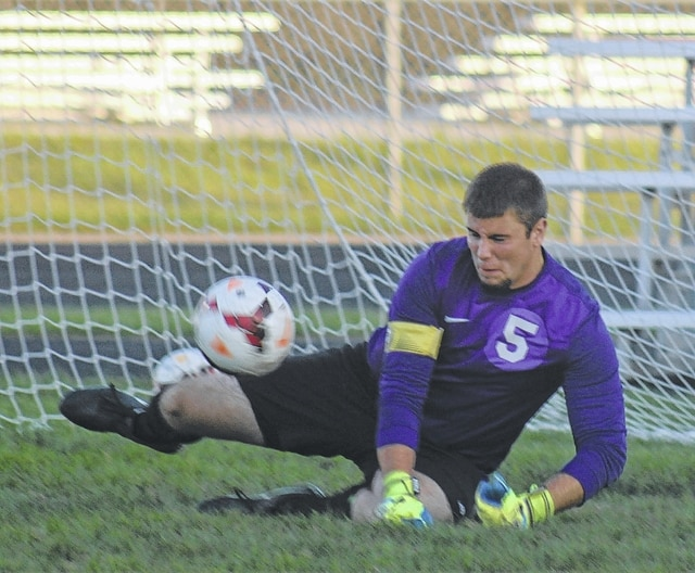 Miami Trace's senior goalkeeper, Tim Kinzler, blocks a shot attempt during an SCOL match against Hillsboro Tuesday, Oct. 11, 2016 at Miami Trace High School.