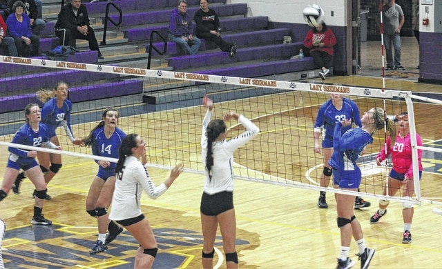 Madalyn Wayne, at right, near net, is about to make the hit for Washington during a Division II Sectional championship match at Unioto High School Saturday, Oct. 22, 2016. Pictured for Washington (l-r); Halli Wall, Hannah Haithcock, Miranda Landis, Delaney Greer, Wayne and Haley Maxie.