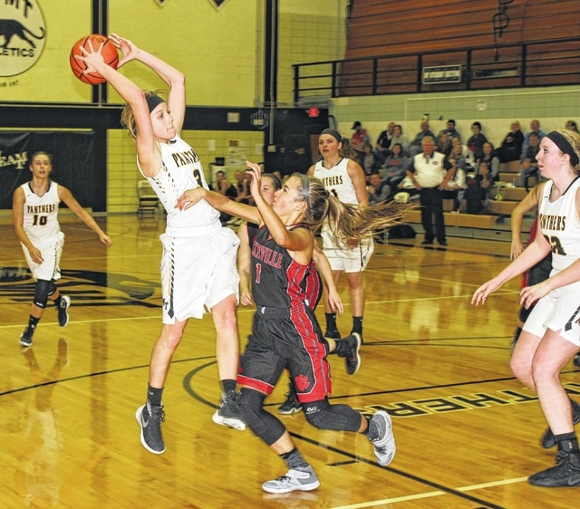 Miami Trace sophomore Cassidy Lovett grabs an offensive rebound in the second half of a non-league game against Circleville Tuesday, Nov. 29, 2016 at Miami Trace High School. Pictured for Circleville is Avery DeLong. Also pictured for Miami Trace (l-r); Shaylee McDonald, Morgan Miller and Samantha Ritenour. Lovett led Miami Trace with eight rebounds.
