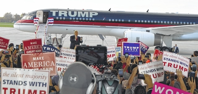 Republican presidential nominee Donald J. Trump claps along with his enthusiastic audience Friday afternoon at the Wilmington Air Park. It was Trump's second rally in Clinton County in just over two months.